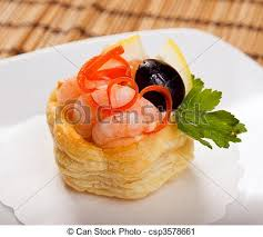 canapes with prawns canapes with prawns and lemon closeup shallow stock photography