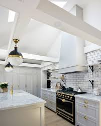 stunning kitchen design with high ceilings and skylights white