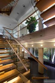 Stairwell Ideas Floating Blonde Wood And Glass Stairwell With Indoor Plant