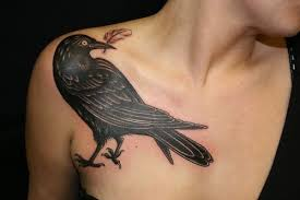 beautiful crow with feather tattoo on right front shoulder