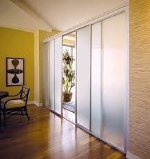 living room design together with frosted glass room divider also