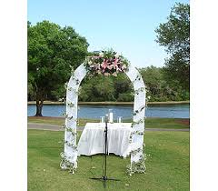 wedding arches using tulle arch with tulle wrapped floral spray in sarasota fl