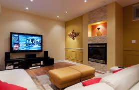family room with sectional and fireplace living room ceiling led lighting black stained wood tv unit