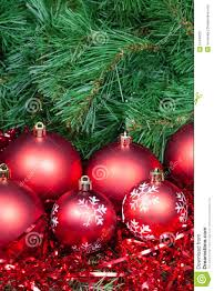 several red christmas baubles tinsel and xmas tree stock image