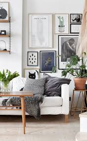 bright living room with light wood white sofa plants and