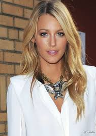 blake lively opens her eyes with a white iridescent eyeshadow in