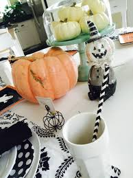 halloween cake plate peach black and white halloween tablescape the style sisters