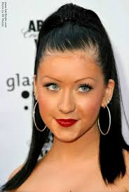 tight hoop earrings aguilera black hair with extensions styled into a