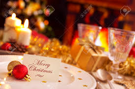 a romantic christmas dinner table setting with candles and a romantic christmas dinner table setting with candles and christmas decorations on the plate a