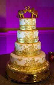 purple flowers on a wedding cake traditional indian wedding in