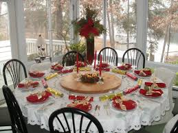 beautiful thanksgiving party with red flowers dining room table