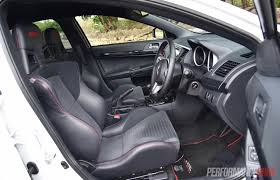 mitsubishi evo interior 2016 2016 mitsubishi lancer evolution vs subaru wrx sti comparison