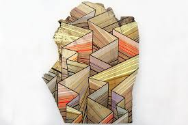 jason middlebrook paints geometric shapes on found wood to