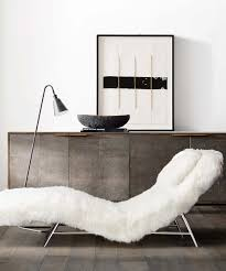 minimalist home decor with shabby sideboard behind fur