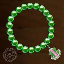 pearl bracelet with charm images Aka green pearl bracelet shield charm zebra lane jpg