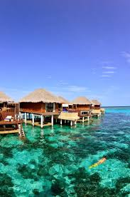overwater bungalows or ocean huts are iconic thatch roo