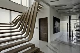 curved wood wall cascading staircase is like an indoor frozen waterfall