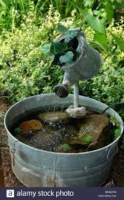 water fountain i made from an old watering can and wash tub i