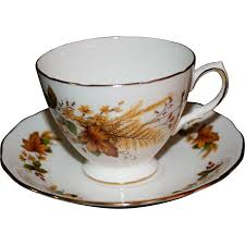 vintage queen anne bone china tea cup and saucer with autumn leaf