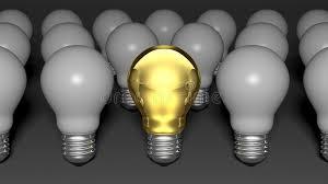 white light bulbs not yellow one golden light bulb among many white light bulbs stock