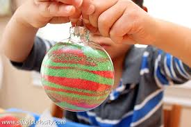 kid made ornament filled with sand gift of curiosity