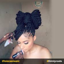 put your hair in a bun with braids how to do a bow hairstyle on braids or locs