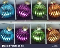 tree baubles in a box on sale in shop stock photo