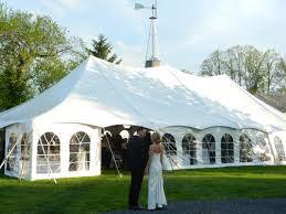 enclosed tent in the backyard weddings at updike farmstead