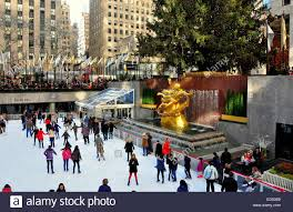 new york city people skating at the rockefeller center ice rink