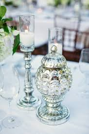 Accessorize Your End Table With Silver Vases And Votives by Top 11 Wedding Flower Tips From The Pros Wedding Flowers
