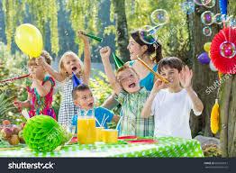 children party hats trumpets during garden stock photo 606925013