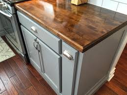 after picture of kitchen with butcher block counter top pull out