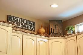 top of kitchen cabinet greenery pin on antique signs
