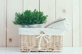 home decor vintage wicker basket house plant and a stack of