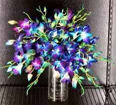 Blue Orchid Flower - purple green orchid dahlia protea driftwood arrangement our