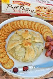puff pastry wrapped brie with cranberries and pecan recipe food