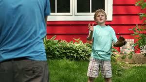 boy playing catch in the backyard stock video footage videoblocks