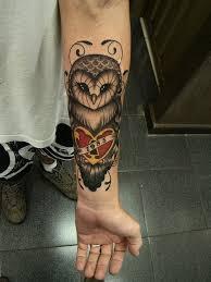 owl tattoo on wrist shared by silvia on we heart it