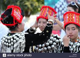 unidentified burmese preparing traditional costumes for a