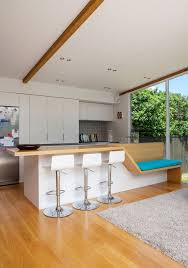 Kitchen Island Extension by Spacious Auckland Bungalow Gets A Modern Glass And Timber