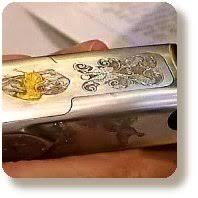 gold inlay engraving scrollwork engraving
