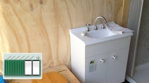 shipping container house installing bathroom sink basin vanity