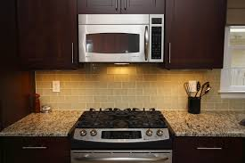 Brown Subway Tile Backsplash by Kitchen Backsplash Ideas White Cabinets Brown Countertop Subway