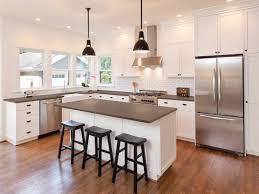 white kitchen cabinets brown countertops fossil brown quartz