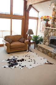 Plus Rug Rugs White Cow Skin Rug With Brown Armchair And Stone Fireplace