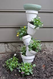 best 25 flower pot tower ideas on pinterest stacked flower pots