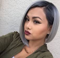 pictures of womens short dark hair with grey streaks woman with a short bob gray silver hair dark roots wearing a
