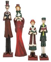a family figurine set singing carols home