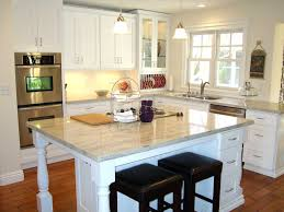 modern white wooden galley kitchen with small marble top kitchen