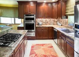 bold kitchen backsplash tile downingtown pa maclaren kitchen warm neptune bordeaux granite kitchen with dark cherry cabinetry